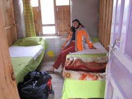 A trekker resting inside a tea-house room